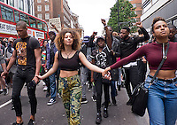 "Maryam Ali  founder of london movement ""Black Lives Matter""  Over a thousand people marched through London chanting ""hands up don't shoot"".  The black community was outraged by US police brutality after killing of two black men - one in Minnesota and one in Louisiana."