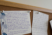 Letters written to the Human Rights Initiative of North Texas are posted on a bulletin board at their office office in Dallas, Texas on July 16, 2014. <br /> CREDIT: Cooper Neill for The Wall Street Journal<br /> SLUG: IMMIGCOURTS
