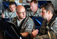 23 JUNE 2012 -- ST. LOUIS -- Missouri Air National Guard Tech Sgt. Paul Holzen (left) confers with Staff Sgt. Toby Callaway about their score during a rehearsal of the 571st Air Force Band at Lambert Field in St. Louis Saturday, June 23, 2012. The group, which is attached to the 131st Fighter Wing of the Eighth Air Force, was organized in 1941 and has been based in St. Louis since 1946.  It is being hosting a final tour of the Midwest this summer, and will be decommissioned in September 2013. Photo © copyright 2012 Sid Hastings.