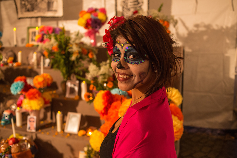New York, NY, October 31, 2013. A woman in face paint stand before the public altar.