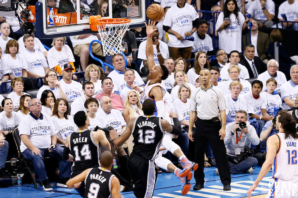 08 May 2016: Oklahoma City Thunder guard Russell Westbrook (0) goes for the layup past San Antonio Spurs forward LaMarcus Aldridge (12) during the Oklahoma City Thunder 111-97 victory over the San Antonio Spurs, during Game Four of the Western Conference Semifinals of the NBA Playoffs at the Chesapeake Energy Arena, Oklahoma City, Oklahoma, USA.