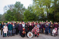 Runnymede, UK. 1st May, 2019. Datchet Border Morris pose with local supporters following a display of traditional morris dancing at sunrise on May Day. An all male Border Morris side with a mixed band, Datchet Border Morris have been dancing on the same site on May Day for 25 years.