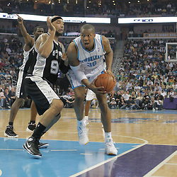 29 March 2009: New Orleans Hornets forward David West (30) drives past San Antonio Spurs center Drew Gooden (90) during a NBA game between Southwestern Conference rivals the New Orleans Hornets and the San Antonio Spurs at the New Orleans Arena in New Orleans, Louisiana.