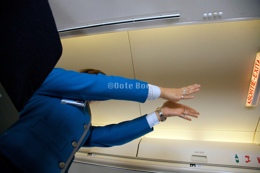 KLM stewardess giving safety instructions