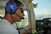 Pilot flying a Cessna plane