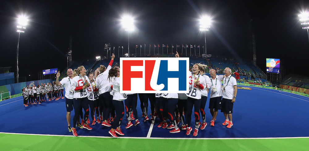 RIO DE JANEIRO, BRAZIL - AUGUST 19:  Great Britain celebrate after winning the Gold medal match on penalties against the Netherlands during the Women's hockey Gold medal match between The Netherlands and Great Britain on Day 14 of the Rio 2016 Olympic Games held at the Olympic Hockey Centre on August 19, 2016 in Rio de Janeiro, Brazil.  (Photo by David Rogers/Getty Images)