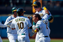 OAKLAND, CA - JULY 28:  Khris Davis #2 of the Oakland Athletics is congratulated by teammates after a walk off RBI during the ninth inning against the Texas Rangers at the RingCentral Coliseum on July 28, 2019 in Oakland, California. The Oakland Athletics defeated the Texas Rangers 6-5. (Photo by Jason O. Watson/Getty Images) *** Local Caption *** Khris Davis