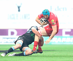 Scarlets' Tadhg Beirne is tackled by Glasgow Warriors' Callum Gibbins<br /> <br /> Photographer Simon King/Replay Images<br /> <br /> Guinness PRO14 Round 19 - Scarlets v Glasgow Warriors - Saturday 7th April 2018 - Parc Y Scarlets - Llanelli<br /> <br /> World Copyright © Replay Images . All rights reserved. info@replayimages.co.uk - http://replayimages.co.uk