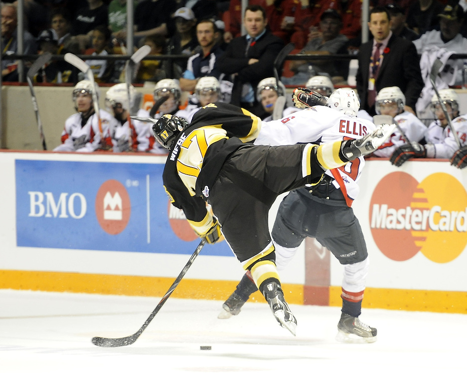 Shayne Wiebe of the Brandon Wheat Kings and Ryan Ellis of the Windsor Spitfires collide in the opening game of the 2010 MasterCard Memorial Cup in Brandon, MB. Photo by Aaron Bell/CHL Images