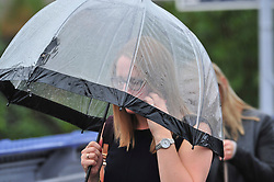 &copy; Licensed to London News Pictures. 09/08/2018. Petts Wood, UK. Commuters shelter underneath umbrellas form the rain at Petts Wood train station, Petts Wood, south east London as the sunny weather is replaced with rain.<br /> Photo credit: Grant Falvey/LNP