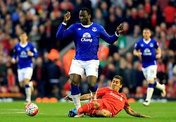 Everton's Romelu Lukaku is tackled by Roberto Firmino of Liverpool - Mandatory by-line: Matt McNulty/JMP - 20/04/2016 - FOOTBALL - Anfield - Liverpool, England - Liverpool v Everton - Barclays Premier League