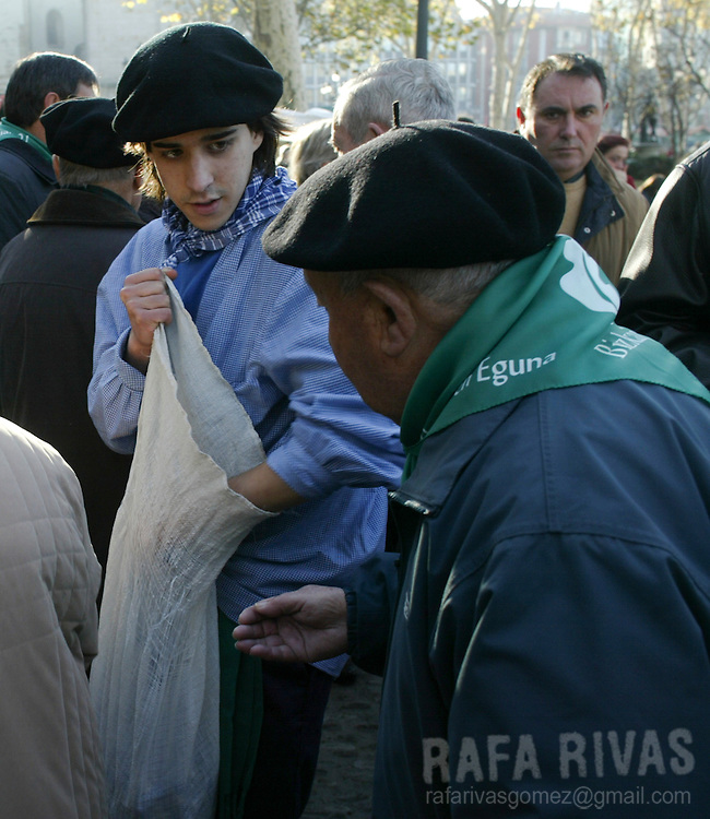 A young man dressed in Olentzero traditional Basque costumes, gives away candies at the Saint Thomas Christmas fair, 21 December 2005 a traditional christmas market in the northern Spanish Basque city of Bilbao where peasants sell their products. Photo Rafa Rivas