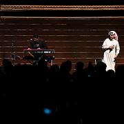 """October 3, 2015 - New York, NY : The performance artist Laurie Anderson collaborated with former Guantánamo detainee, Mohammed el Gharani, in the production of """"Habeas Corpus,"""" an art installation featuring a larger-than-life projection of el Gharani displayed in the Park Avenue Armory drill hall. Here, the Syrian-born musician Omar Souleyman performs on stage in """"Out of Body,"""" a performance component of the exhibit held in the drill hall on Friday night. Keyboardist Chadi Kerio is pictured at left. CREDIT: Karsten Moran for The New York Times"""