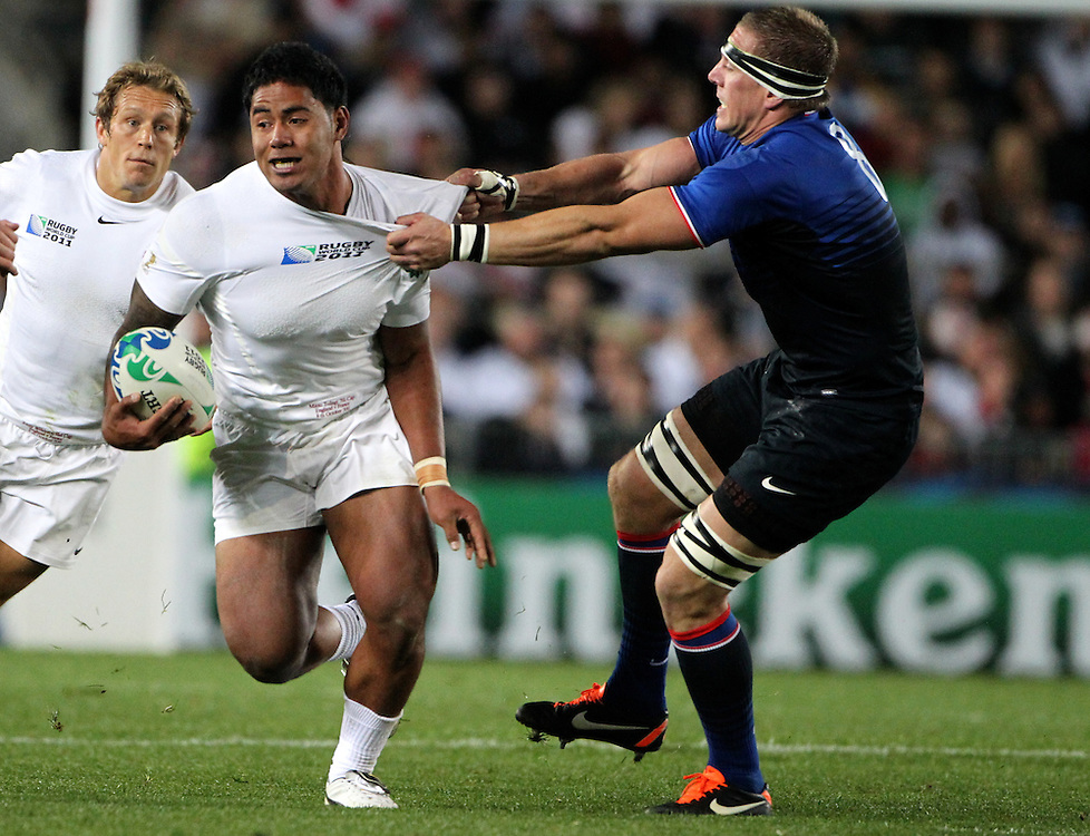England's Manu Tuilagi is tackled by Frances Imanol Harinordoquy in their Rugby World Cup quarter-final match at Eden Park, Auckland,  New Zealand, Saturday, October 08, 2011. Credit:SNPA / John Cowpland