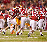 Nov 12, 2011; Fayetteville, AR, USA;  Arkansas Razorbacks quarterback Tyler Wilson (8) hands the ball to runningback Dennis Johnson (33) during a game at Donald W. Reynolds Razorback Stadium. Arkansas defeated Tennessee 49-7. Mandatory Credit: Beth Hall-US PRESSWIRE