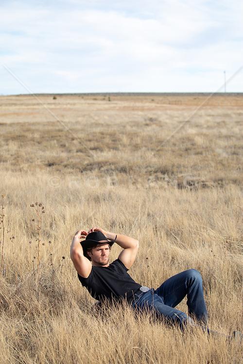 cowboy relaxing in a field