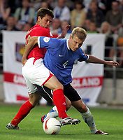 Photo: Paul Thomas.<br /> Estonia v England. UEFA European Championships Qualifying, Group E. 06/06/2007.<br /> <br /> Michael Owen (L) of England battles with Ragnar Klavan.