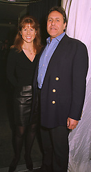 The HON.AURELIA CECIL and MR CHRISTOPHER LEIGH-PEMBERTON, at a party in London on 18th February 1999.MOM 24