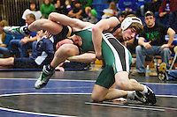Timberlake High's Drew Hill hangs onto Brandon Pugh from St. Maries High as he is lifted into the air during the 125-pound match Friday at the Coeur d'Alene Invitational. Hill won the match with a pin in the second period.