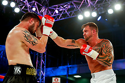 Lee Nutland of Bristol (white shorts) on his way to a points victory over Paul Morris (black shorts) in a Cruiserweight bout on the undercard - Photo mandatory by-line: Rogan Thomson/JMP - 07966 386802 - 13/06/2015 - SPORT - BOXING - Bristol, England - Action Indoor Sports Arena - Lee Haskins vs Ryosuke Iwasa - Interim IBF World Bantamweight Title Fight - UNDERCARD.