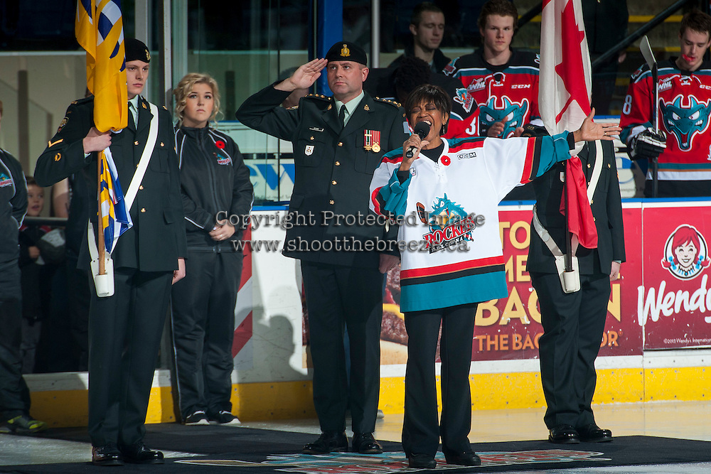 KELOWNA, CANADA - NOVEMBER 11: TeenaRee Gowdy sings the national anthem as military officials stand on guards the Kelowna Rockets take on the Vancouver Giants on November 11, 2015 at Prospera Place in Kelowna, British Columbia, Canada.  (Photo by Marissa Baecker/Getty Images)  *** Local Caption *** TeenaRee Gowdy;