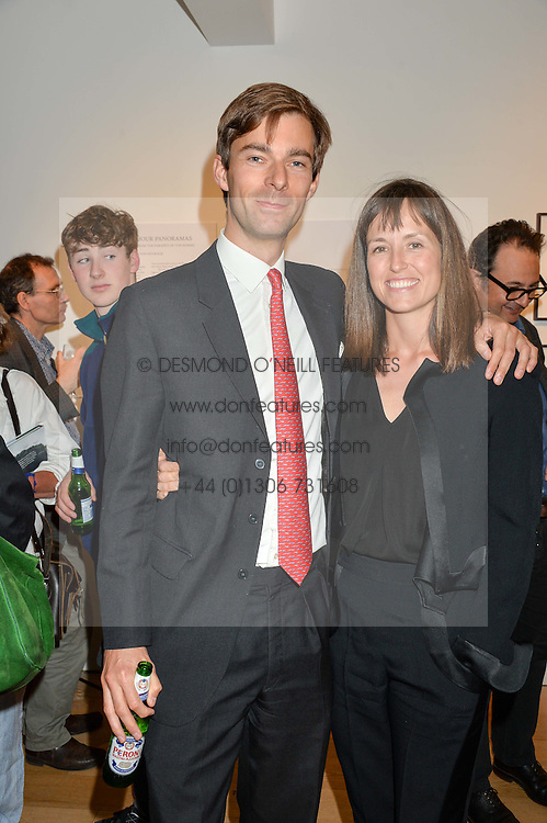 VISCOUNT & VISCOUNTESS GRIMSTON at a private view of photographs by Jolyon Fenwick 'The Zero Hours Panoramas' 100 Years On: Views From The Parapet of The Somme held at Sladmore Contemporary, 32 Bruton Place, London on 30th June 2016.