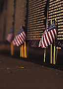 "Small American flags left by visitors line the bottom of the Traveling Vietnam Veterans Memorial, the ""Traveling Wall"",  during its stay in Petoskey, Michigan."