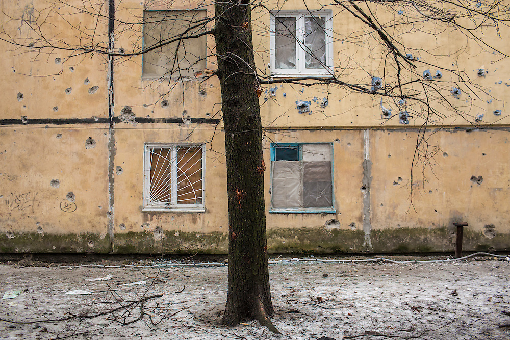 DONETSK, UKRAINE - JANUARY 23, 2015: Damage to an apartment building next to where a rocket landed two days earlier in Donetsk, Ukraine. After the rebels finally took control of the heavily contested airport in Donetsk from the Ukrainian Army, they have promised an offensive to extend their territory further. CREDIT: Brendan Hoffman for The New York Times