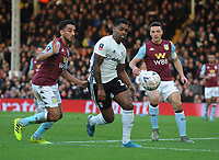 Football - 2019 / 2020 Emirates FA Cup - Third Round:  Fulham vs. Aston Villa<br /> <br /> Ivan Cavaleiro of Fulham moves in between James Chester and Neil Taylor of Villa, at Craven Cottage.<br /> <br /> COLORSPORT/ANDREW COWIE