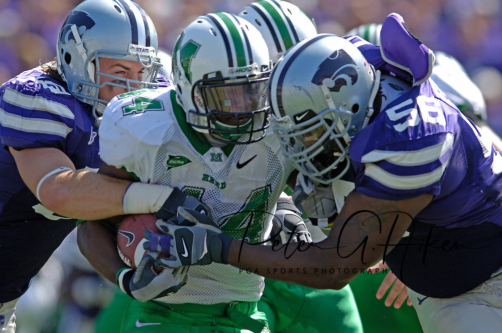 Marshall running back Ahmad Bradshaw (C) is wrapped up by Kansas State defenders Quintin Echols (R) and Steven Cline (L) in the first half, at Bill Snyder Family Stadium in Manhattan, Kansas, September 16, 2006.  The Wildcats beat the Thundering Herd 23-7.