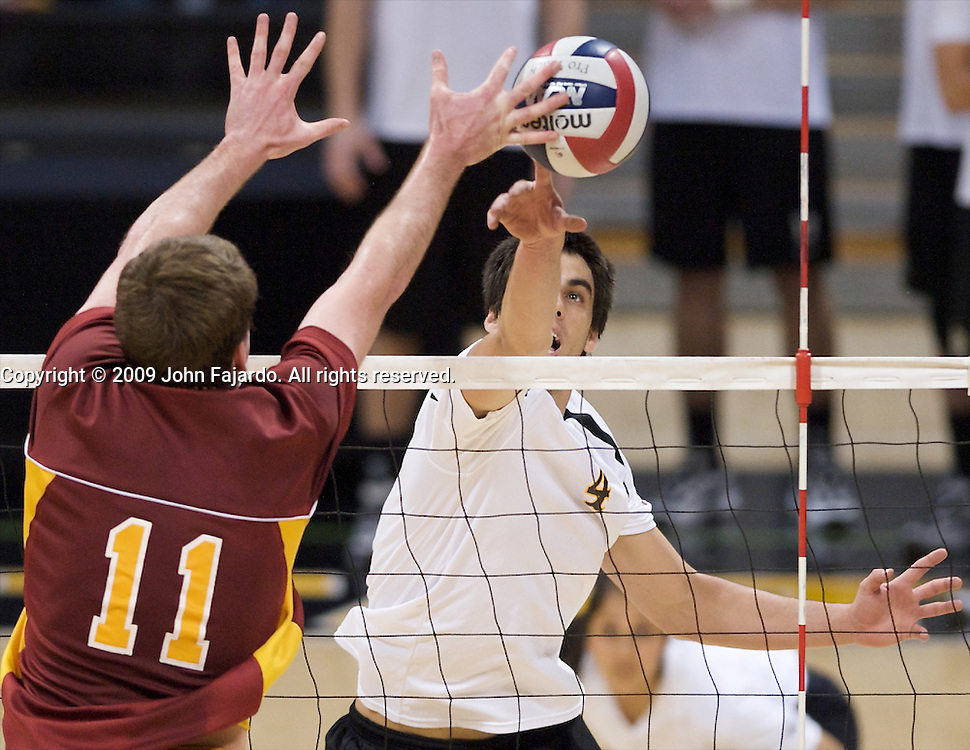 Tommy Pestolesi attempts to poke the ball past Murphy Troy(11) in Mountain Pacific Sports Federation play against USC at the Walter Pyramid, Long Beach CA, Wednesday, March 4, 2009.  Long Beach State loses in five sets, 31-29, 24-30, 30-23, 23-30, 13-15.