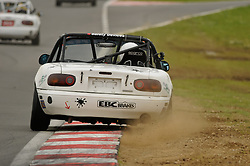 Matt Davies kicks up the dust exiting Murray's in his Ma5da Racing Mk1 MX-5 at Snetterton.