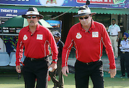 Umpires Richard Illingworth (England) and Paul Reiffel (Australia) walking out onto the field during the Qualifier match 1 of the Karbonn Smart Champions League T20 (CLT20) between Otago Volts and the Faisalabad Wolves held at the Punjab Cricket Association Stadium, Mohali on the 17th September 2013. Photo by Jacques Rossouw/CLT20/SPORTZPICS<br /> <br /> <br /> Use of this image is subject to the terms and conditions as outlined by the CLT20. These terms can be found by following this link:<br /> <br /> http://sportzpics.photoshelter.com/image/I0000NmDchxxGVv4<br /> <br /> ENTER YOUR EMAIL ADDRESS TO DOWNLOAD
