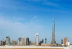 Skyline of Dubai with Burj Khalifa tower prominent in United Arab Emirates , UAE