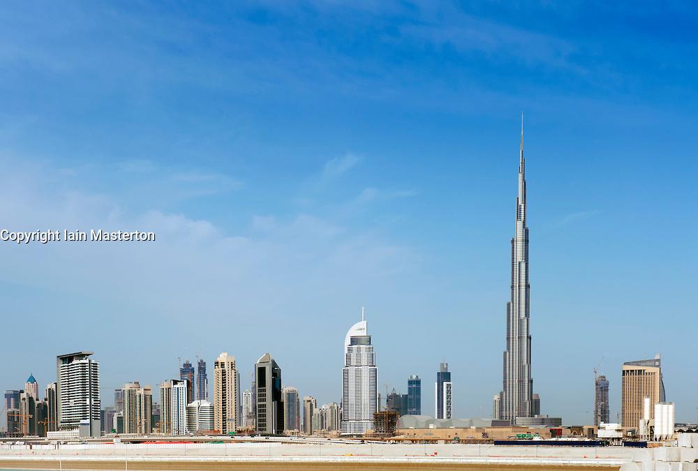 Skyline of Dubai with Burj Khalifa tower prominent in United Arab Emirates , UAE