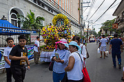 Tourists and locals taking pictures with one of the floats from the Grand Marian Procession in Intramuros, Metro Manila, Philippines.  (photo by Andrew Aitchison / In pictures via Getty Images)
