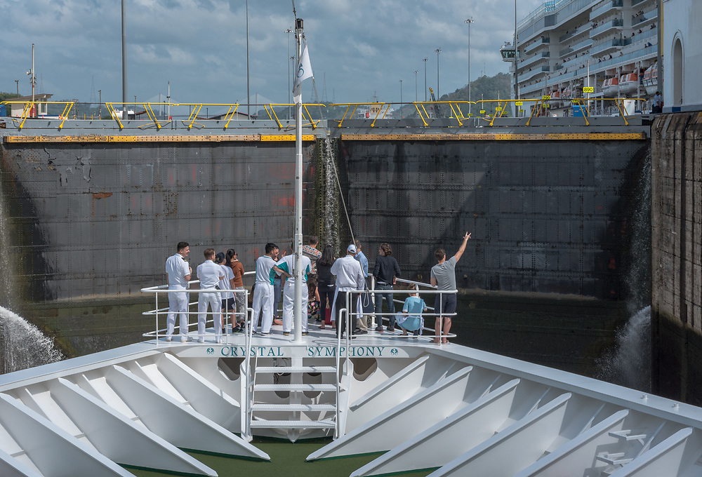 Panama Canal, Panama--April 18, 2018. Crew of a cruise ship watches as the ship approaches the locks of the Panama Canal. Editorial use only.