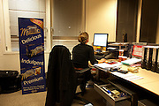 Long-after dark, a lady employee works late at the United Biscuits Group offices, Hayes London