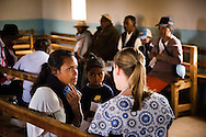 A patient describes symptoms to Molly Christiansen as the Mercy Medical Team treats patients Saturday, Oct. 18, 2014, at a Fiangonana Loterana Malagasy (FLM) Lutheran church in Antsoantany, Madagascar. LCMS Communications/Erik M. Lunsford