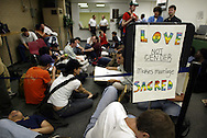 Gay marriage rights demonstrators stage a sit-in at the office of Cook County Clerk David Orr Monday afternoon after being denied marriage licenses.