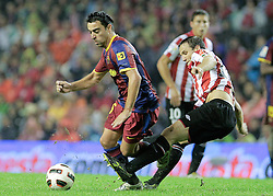 25.09.2010, San Mames, Bilbao, ESP, Primera Division, Athletic Bilbao vs FC Barcelona, im Bild FC Barcelona's Xavi Hernandez (l) and Athletic de Bilbao's Carlos Gurpegui during La Liga match. EXPA Pictures © 2010, PhotoCredit: EXPA/ Alterphotos/ Acero +++++ ATTENTION - OUT OF SPAIN / ESP +++++