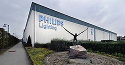 A statue of Icarus, from Greek mythology, stands at the entrance of the Philips Lighting factory campus, in Turnhout, Belgium, on Friday, Oct. 15, 2010. (Photo © Jock Fistick)