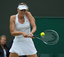 LONDON, ENGLAND - Saturday, June 25, 2011: Maria Sharapova (RUS) in action during the Ladies' Singles 3rd Round match on day six of the Wimbledon Lawn Tennis Championships at the All England Lawn Tennis and Croquet Club. (Pic by David Rawcliffe/Propaganda)