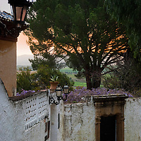 Beautiful pastel colors during sunrise in a narrow street in Ronda (Andalusia)