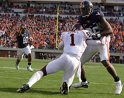 Virginia quarterback Jameel Sewell (10) directs Virginia wide receiver Maurice Covington (80) to block Virginia Tech cornerback Victor Harris (1) as he heads to the endzone.  The #8 ranked Virginia Tech Hokies defeated the #16 ranked Virginia Cavaliers 33-21 at Scott Stadium in Charlottesville, VA on November 24, 2007.