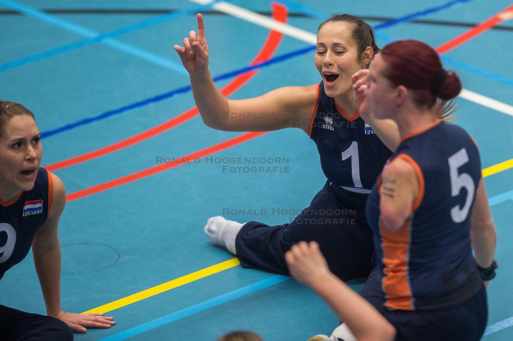 14-02-2016 NED: Nederland - Oekraine, Houten<br /> De Nederlandse paravolleybalsters speelde een vriendschappelijke wedstrijd tegen Europees kampioen Oekraïne. De equipe van bondscoach Pim Scherpenzeel bereidt zich tegen Oekraïne voor op het Paralympisch kwalificatietoernooi in China, dat in maart wordt gespeeld /   Karin van der Haar #5 of Nederland,  Elvira Stinissen #1 of Nederland