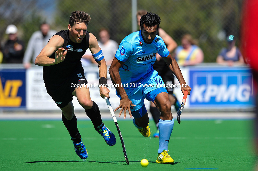 Dharamvir Singh of India eludes Simon CHILD of the Black Sticks during the Mens Hockey International, 2015 South Island Tour game between the New Zealand Black Sticks V India, at Marist Park, Christchurch, on the 11th October 2015. Copyright Photo: John Davidson / www.photosport.nz