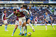 Frederic Guilbert (Aston Villa) & Bernardo Fernandes da Silva Junior (Brighton) in a tackle during the Premier League match between Brighton and Hove Albion and Aston Villa at the American Express Community Stadium, Brighton and Hove, England on 18 January 2020.