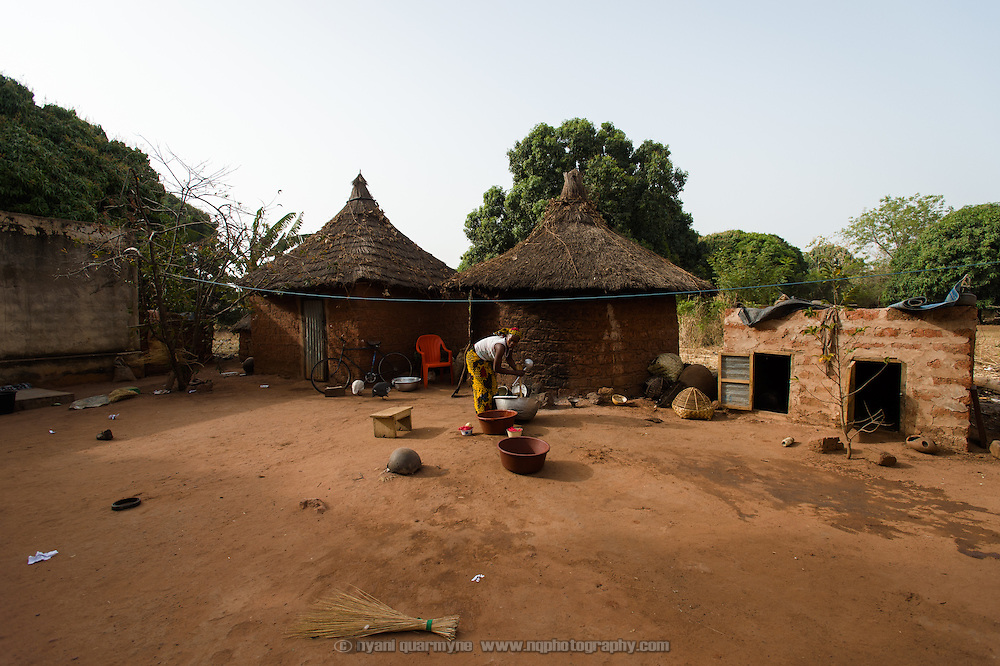 Marie Madeleine Ouattara washing her dishes in the village of Toussiana in the Hauts-Bassins region of Burkina Faso, on 22 February 2016. She lives in an extended family household, and she and her husband's brother's wife take it in turns to cook.