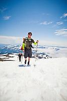 Hiker / climbers making their way up the Muir snow field on Mounta Rainier in Washington state, USA.